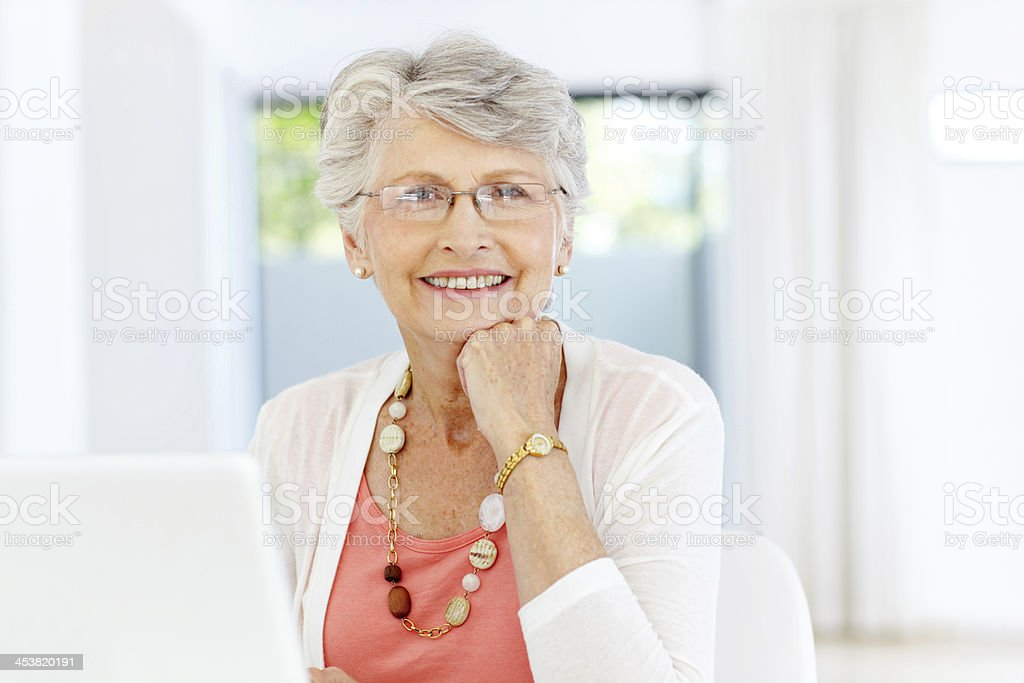 Happy with her laptop purchase - Seniors/Technology royalty-free stock photo