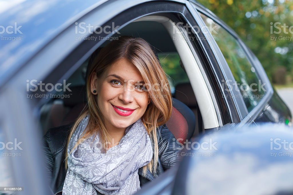 Happy with her new car stock photo