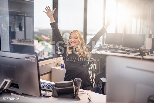 istock Happy with work at the office 507705408