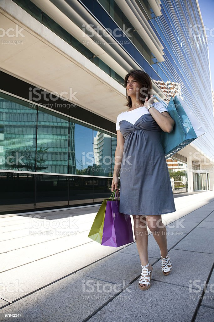 Happy woman after shopping royalty-free stock photo