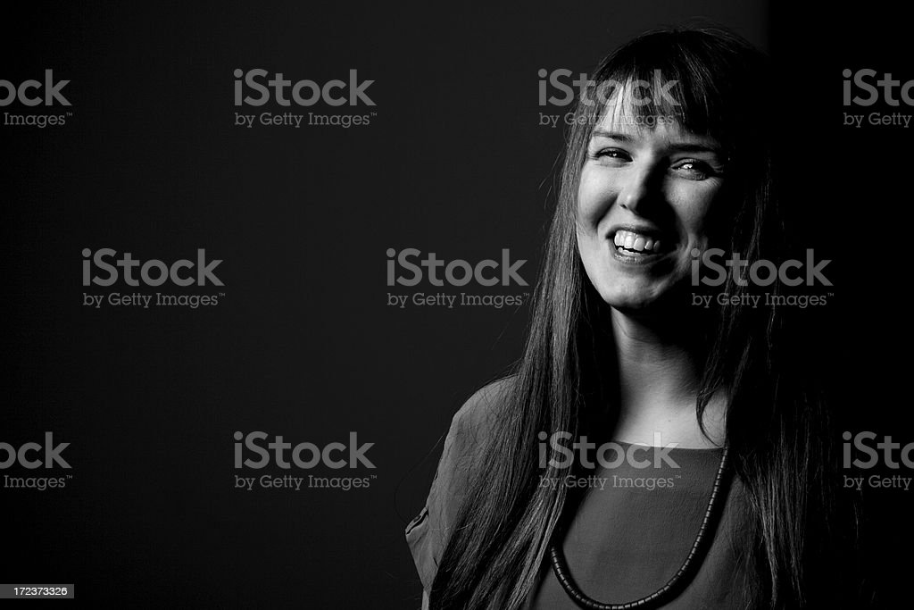 Happy woman against black background stock photo