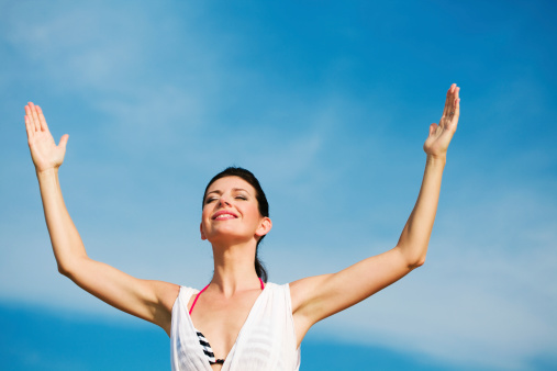 Happy Woman Against Blue Sky Stock Photo - Download Image Now