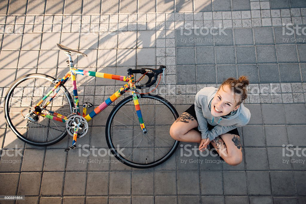 Happy woman and bike in the city stock photo