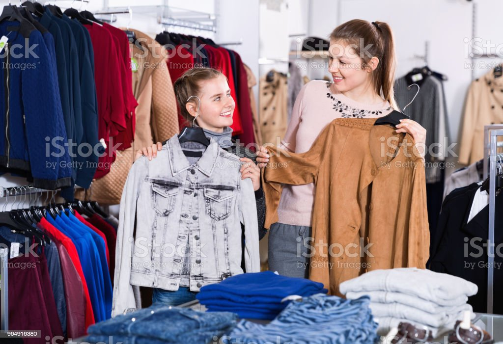 Happy woman and her satisfied daughter enjoying shopping royalty-free stock photo