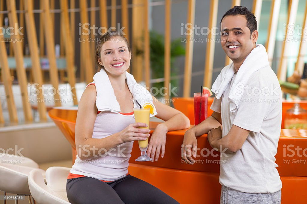 Happy Woman and Man Drinking Smoothies after Sport stock photo