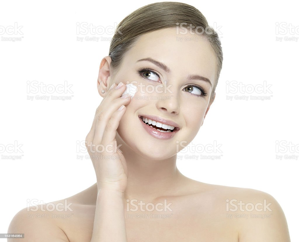Happy woman applying cosmetic cream royalty-free stock photo