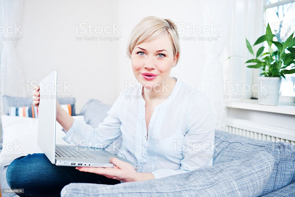 Happy woman at home with laptop royalty-free stock photo