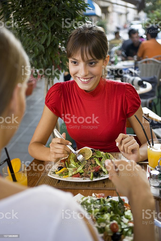 Happy woman at restaurant royalty-free stock photo