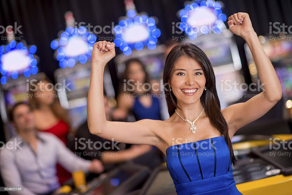 Happy woman at the casino stock photo