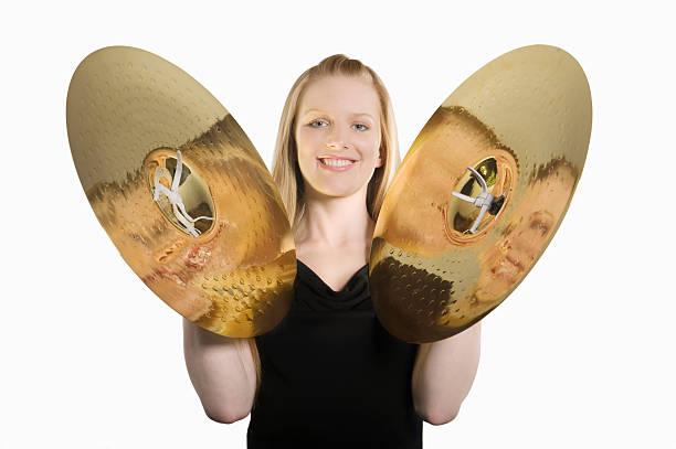 happy woman banging cymbal - cimbaal stockfoto's en -beelden