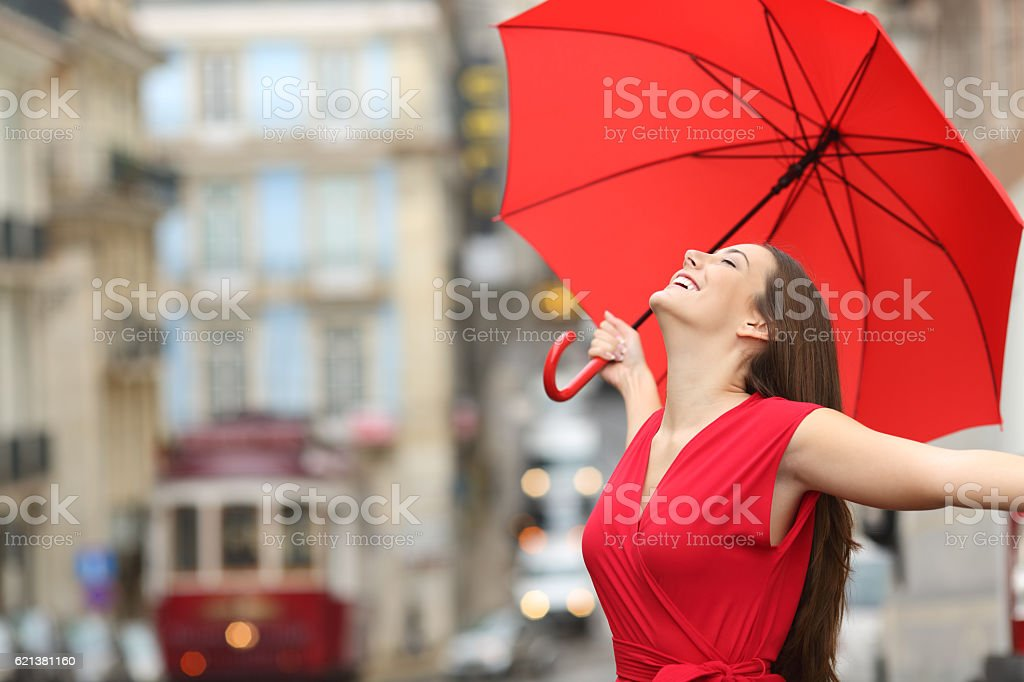 Happy woman breathing in the street stock photo