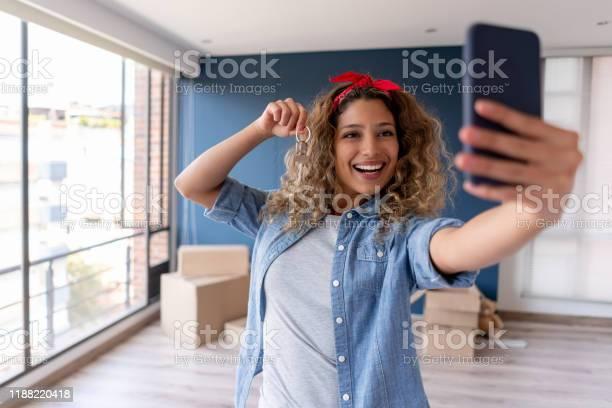 Happy woman buying a house and taking a selfie with the keys picture id1188220418?b=1&k=6&m=1188220418&s=612x612&h=yrmvtlll1logojnmsa3rwblpaqtkalwfy5d594dvogc=