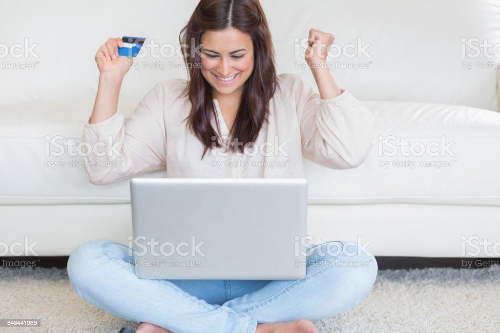 Happy woman buying something online stock photo