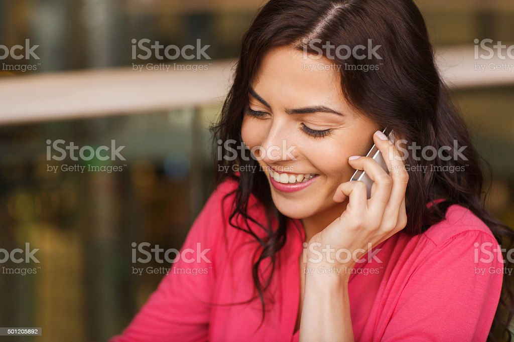 happy woman calling on smartphone at restaurant stock photo
