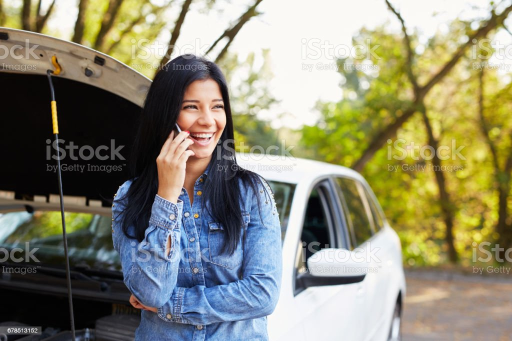 Happy woman calling someone for help stock photo