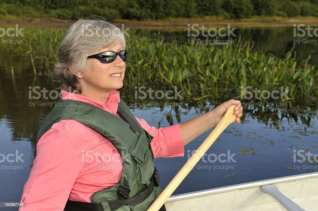 Happy Woman canoeing on lake royalty-free stock photo