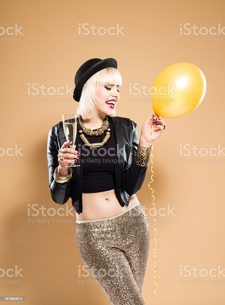 Happy woman celebrating New Year's Day with a champagne stock photo
