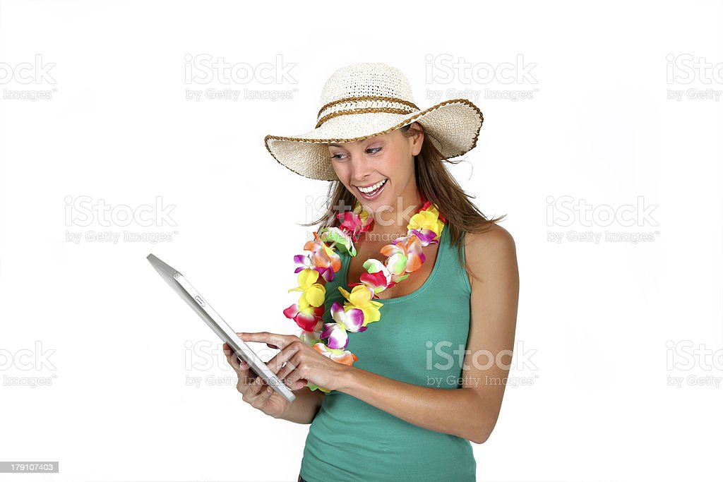 Happy woman choosing tropical holidays on tablet royalty-free stock photo