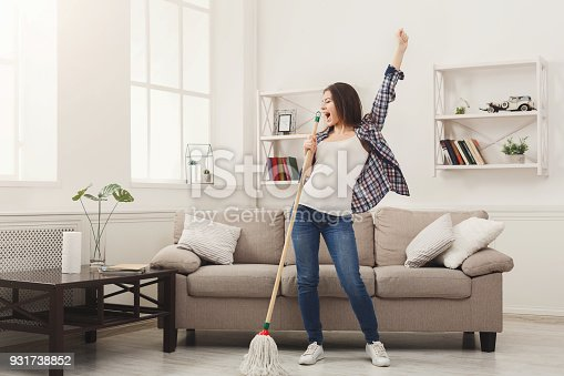 1081403344 istock photo Happy woman cleaning home with mop and having fun 931738852