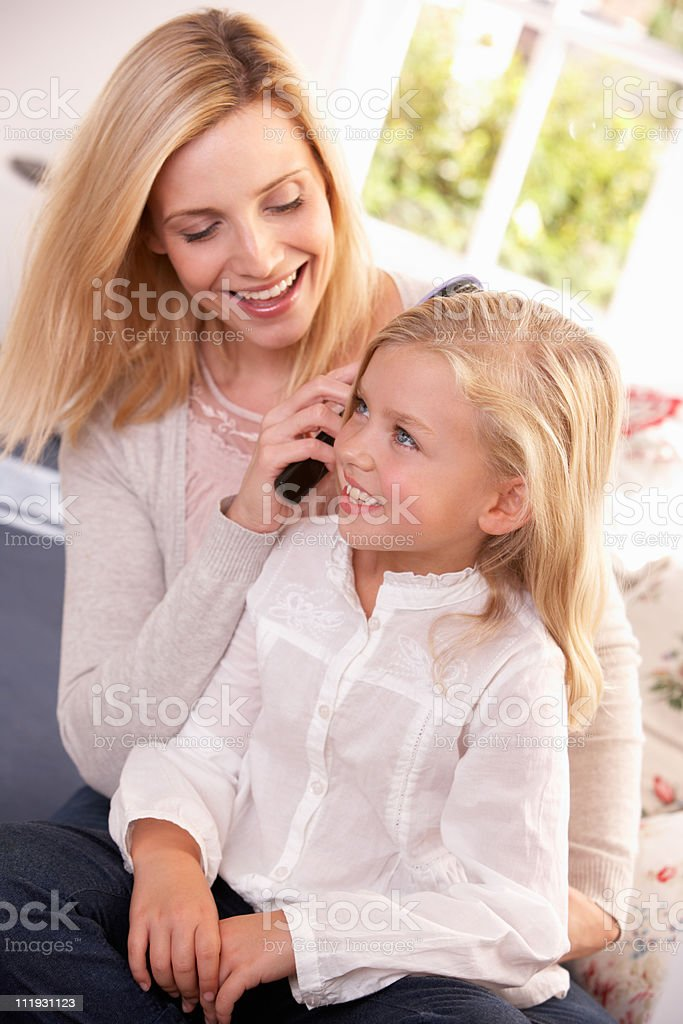 Happy woman combing daughter's hair royalty-free stock photo