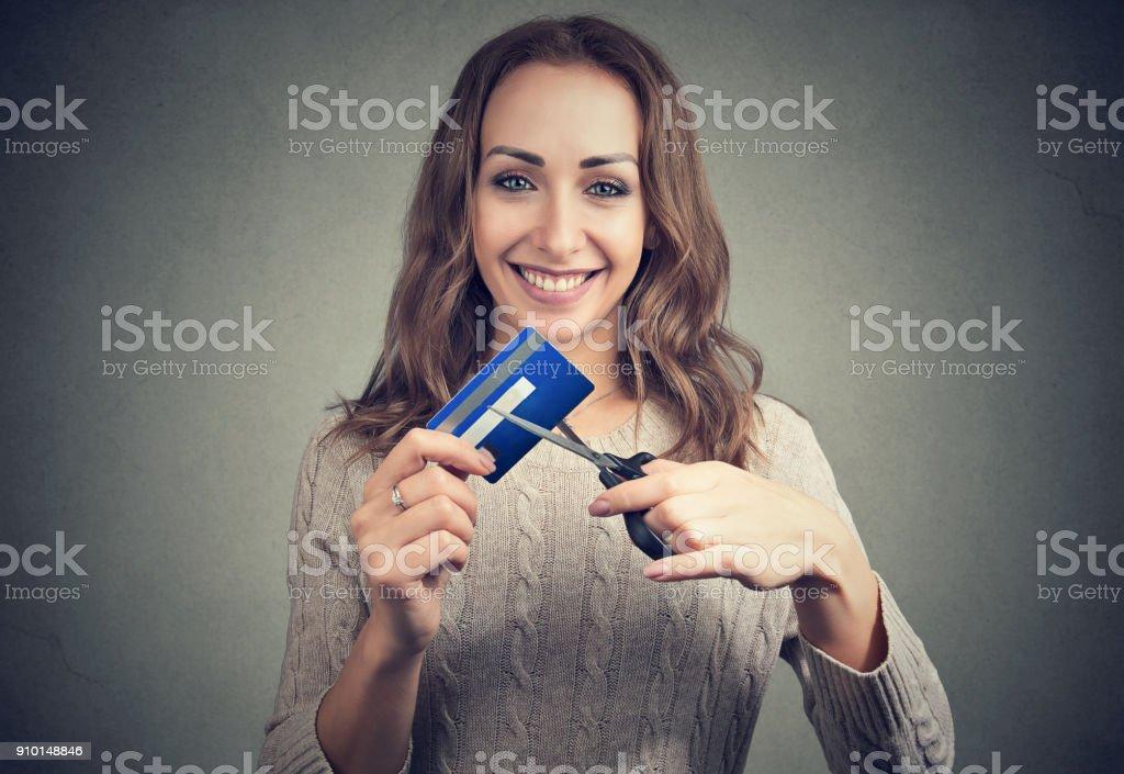 Happy woman cutting credit card stock photo