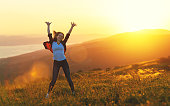 istock Happy woman  dances, jump, rejoices, laughs  on sunset in nature 841358418