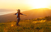 istock Happy woman  dances,  rejoices, laughs  on sunset in nature 839842770