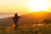 istock Happy woman  dances,  rejoices, laughs  on sunset in nature 840730356