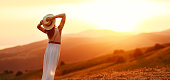 istock Happy woman dancing with her back on sunset in nature 1206622146
