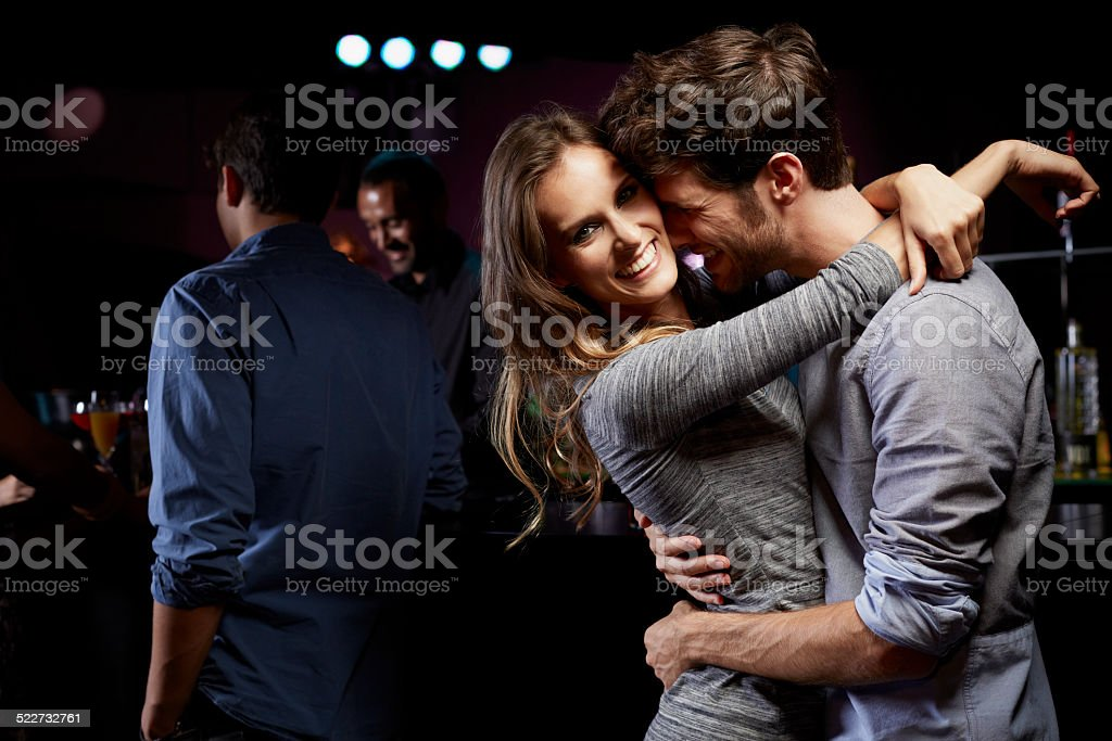 Happy woman dancing with man at nightclub stock photo