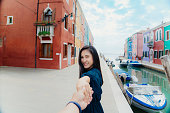 Happy woman day. Outdoors portrait of beautiful asia woman holding boyfriend hand