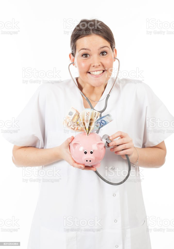 happy woman doctor with piggy bank full of money stock photo