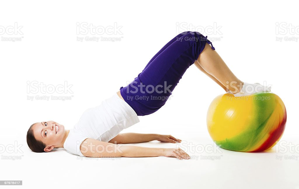 Happy woman doing fitness exercises with ball royalty-free stock photo