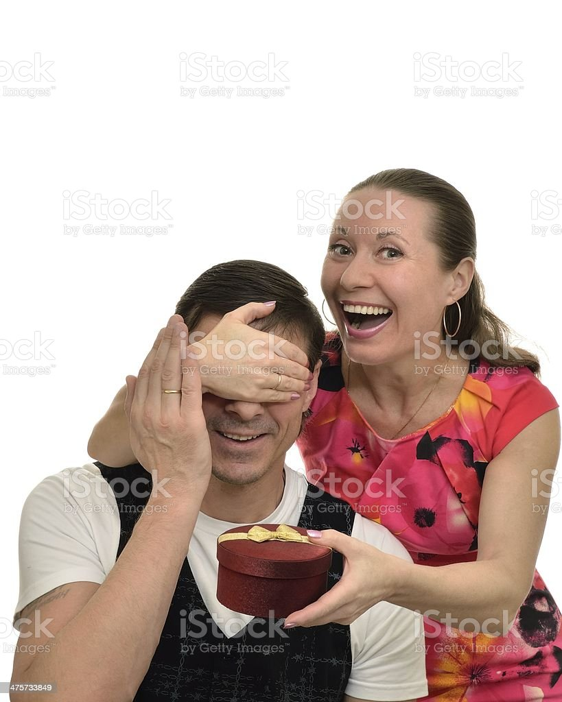 Happy woman doing  surprise gift for the beloved man holiday stock photo