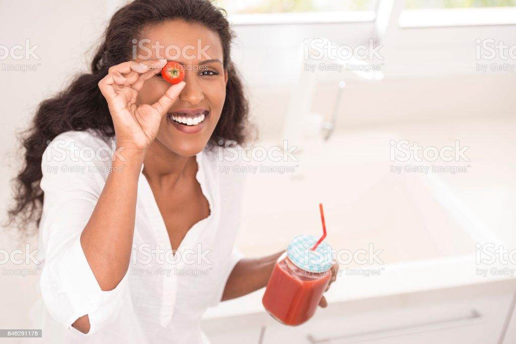 Happy woman drinking healthy tomato juice. stock photo