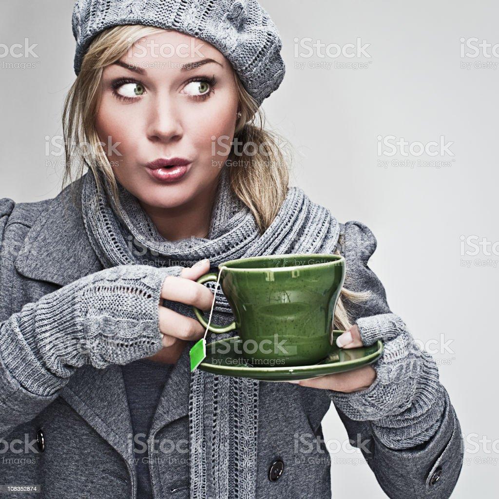 Happy woman drinking tea royalty-free stock photo