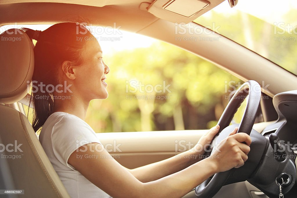 happy woman driver driving her car stock photo