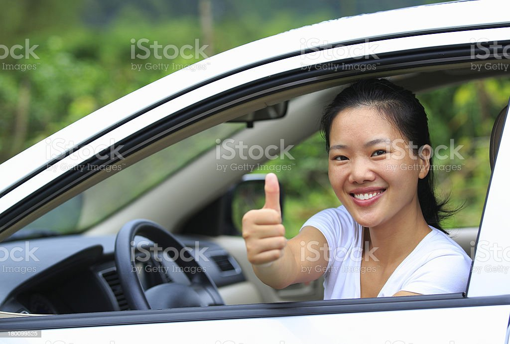 happy woman driver  thumb up royalty-free stock photo