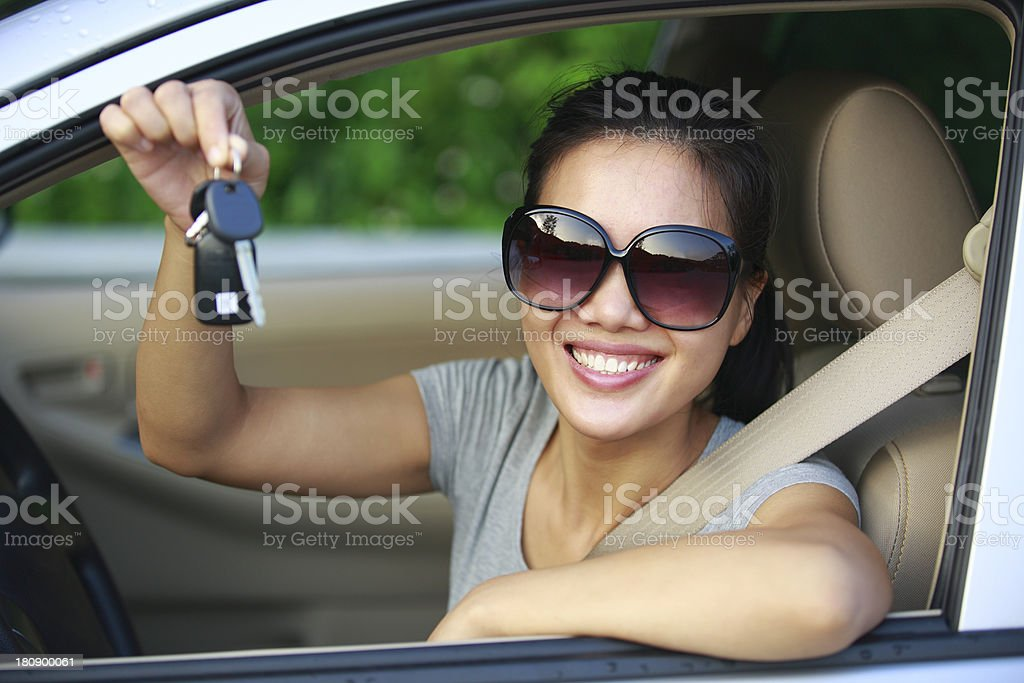 happy woman driver with car keys stock photo