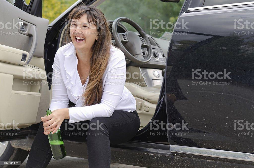 Happy woman drunkard in a car stock photo