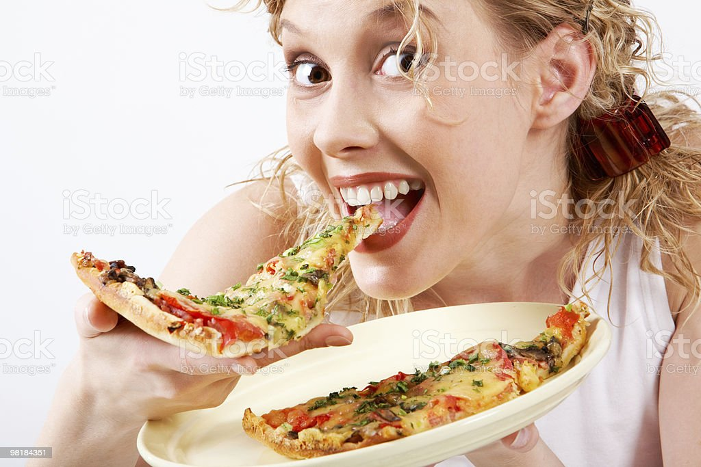 Happy woman eating pizza royalty-free stock photo
