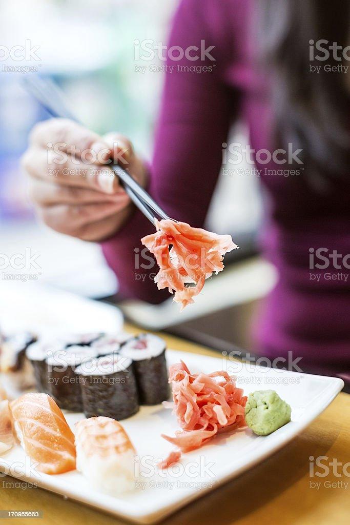 Happy Woman Eating Sushi stock photo