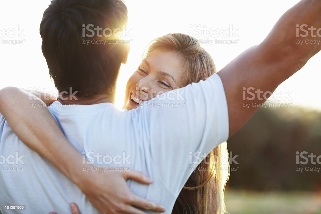 Happy woman embracing man stock photo