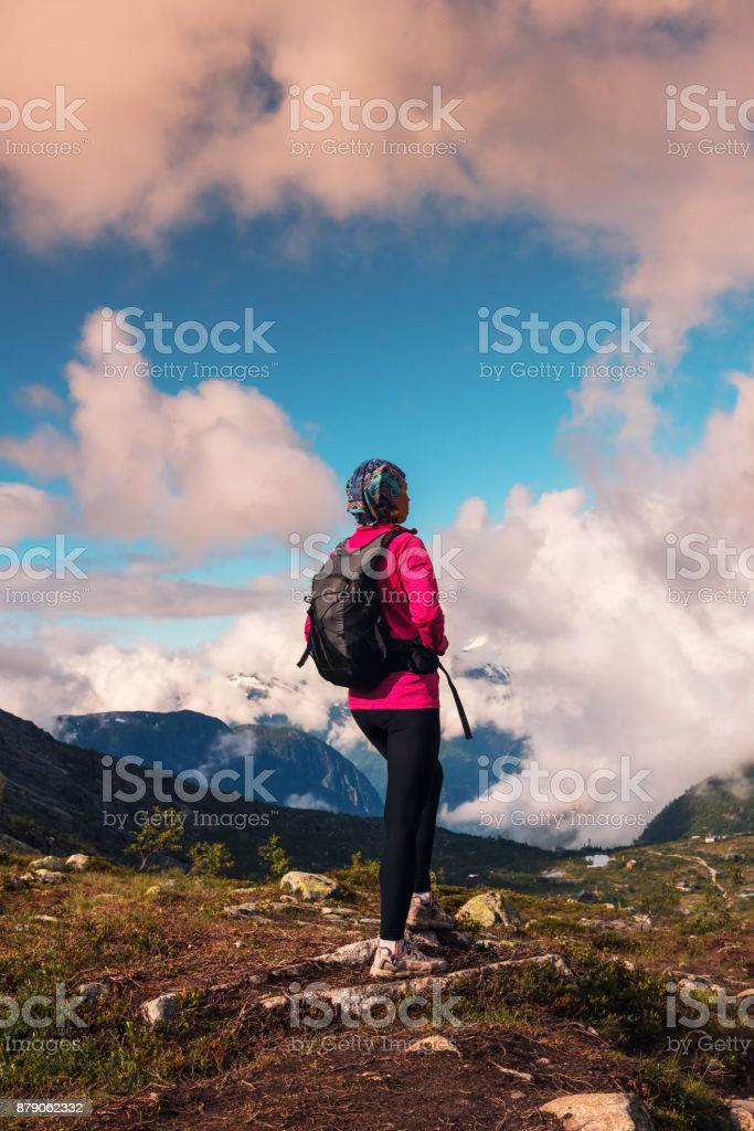 Happy woman enjoy lake and good weather in Norway stock photo