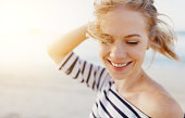 istock happy woman enjoying freedom and laughs on sea 909272692
