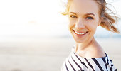 istock happy woman enjoying freedom and laughs on sea 914602476
