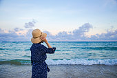 istock Happy woman enjoying freedom on sea 1154925426