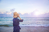 istock Happy woman enjoying freedom on sea 1154925434