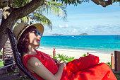 istock Happy woman enjoying freedom on sea 1205701952