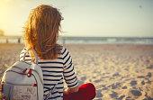 istock happy woman enjoying freedom  on sea 909267710